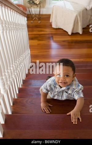 A boy climbing stairs - Stock Photo