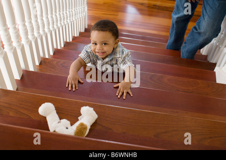 Boy climbing stairs - Stock Photo