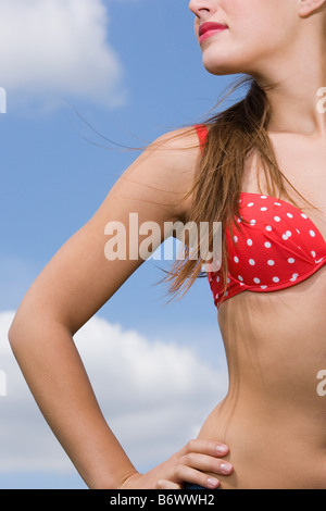 Young woman with hand on hip - Stock Photo
