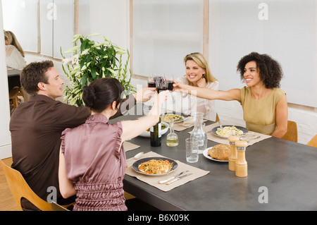 Friends toasting with red wine - Stock Photo