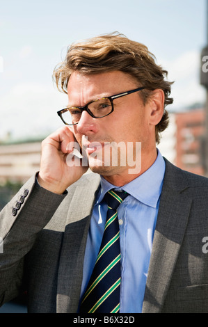 Portrait of businessman with cellphone - Stock Photo