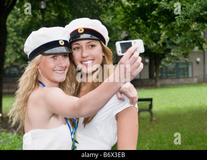 Female students taking picture - Stock Photo