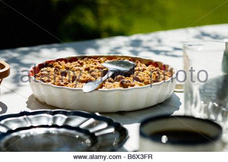 Pie on table in sunlight - Stock Photo