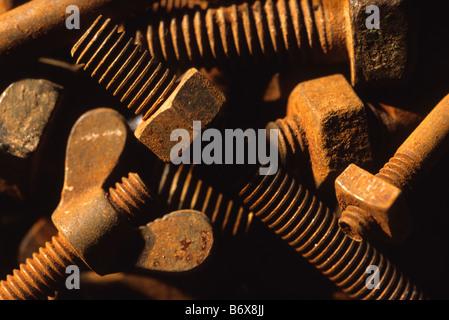 nuts and bolts showing various sizes and threads - Stock Photo