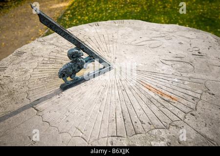 Old horizontal sundial from 1896 in garden. Radziejowice, Poland. - Stock Photo