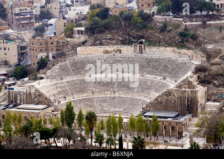 Roman amphitheater in Amman Al Qasr site Capital of Jordan Early morning in autumn with fog - Stock Photo