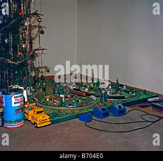 Toy train set up at Christmas, c. 1960 - Stock Photo