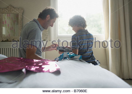 Father giving son Christmas gift - Stock Photo