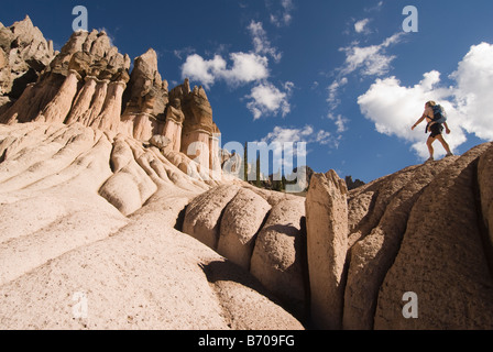 Woman hiking through volcanic towers, Wheeler Geologic Area, Rio Grande National Forest, Colorado. - Stock Photo