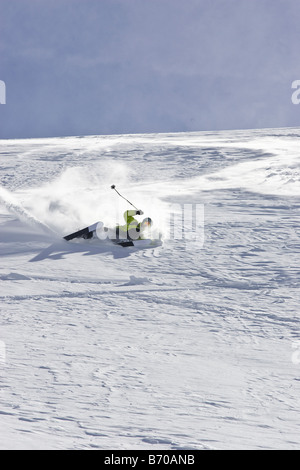A young man falls while skiing untracked powder off-piste at the Stubai Ski Resort, near Innsbruck,  Austria. - Stock Photo