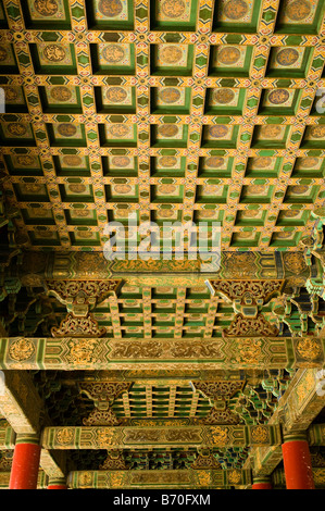 Golden and intricately painted ceiling in China's Forbidden City, Beijing, China - Stock Photo