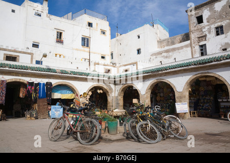 Essaouira Morocco North Africa White buildings and shops around small square in 18th century old town Medina - Stock Photo