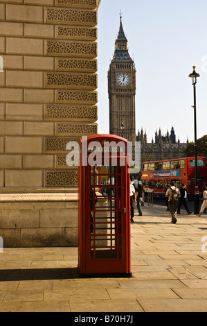 British Telephone booth with Big Ben and Red Double Decker in the background in London - Stock Photo