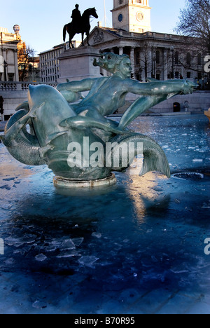 Frozen fountain at Trafalgar Square, London during the coldest winters day in 12 years - Stock Photo