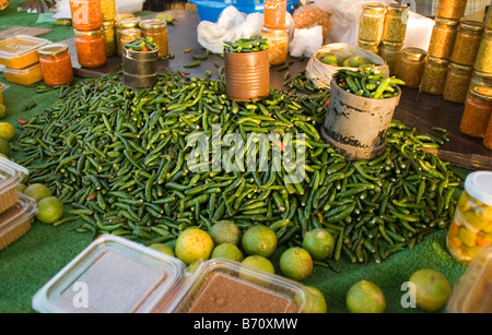 Peppers, limes and spices for sale at a farmer's market in Saint-Paul on the Island of Reunion in the Indian Ocean. - Stock Photo