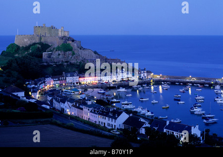 Mount Orgueil Castle, overlooking Grouville Bay in Gorey, Jersey, Channel Islands. The coast of France is visible on the horizon