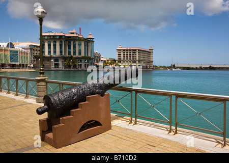 Caudon Waterfront at the harbour in Port Louis Mauritius with historical cannon - Stock Photo