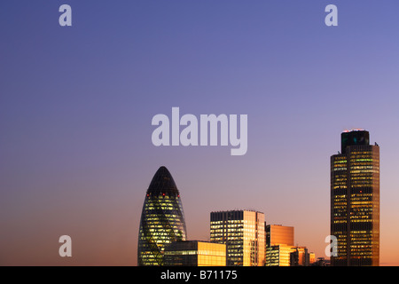 Nat West Tower Gherkin and London skyline at sunset London England - Stock Photo