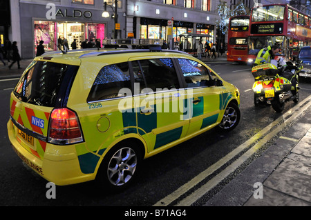 London 'Oxford Street' ambulance paramedic car and motorbike respond to emergency call to this busy West End shopping - Stock Photo