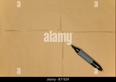 Blank brown paper parcel tied up with string and a marker pen - Stock Photo