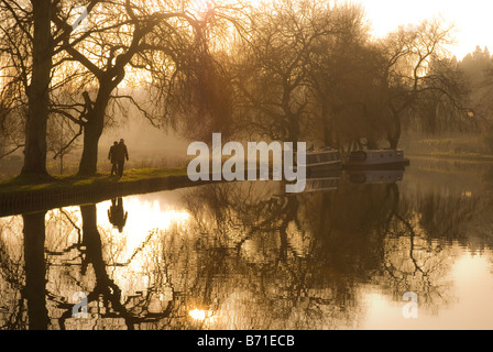 A couple walking along the bank of the River Wey in Guildford, Surrey, England. - Stock Photo