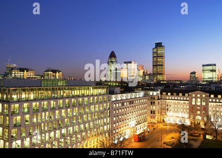 Night shot of Nat West Tower Gherkin and London skyline London England - Stock Photo