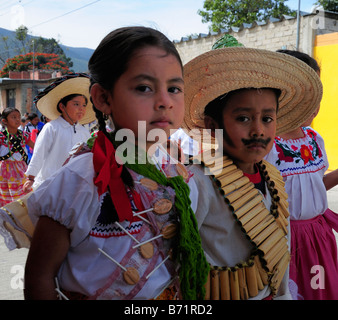 Mexican children in national costume parading on Anniversary of the Revolution - Stock Photo