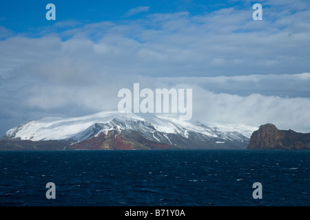 Sailing towards Neptune's Bellows the gap in the flooded volcanic caldera of Deception Island South Shetland Islands - Stock Photo