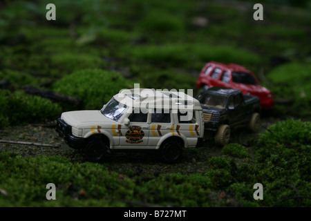 Toy car jeep suv safari Tourists in SUV and pick-up cabs touring the lush green tea estates during their annual - Stock Photo