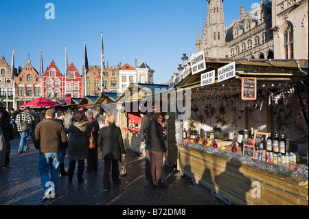 Gluhwein stall at the Christmas Market in the Grote Markt (Main Square), Bruges, Belgium - Stock Photo