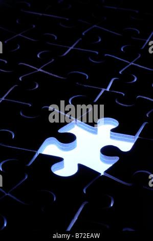 Missing jigsaw piece - Stock Photo