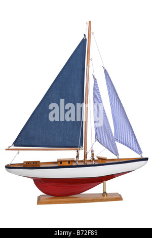 Yacht sail boat model cut out on white background - Stock Photo