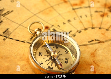 Antique golden compass and old map - Stock Photo