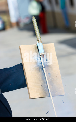 a man launching fireworks rockets with his hands - Stock Photo