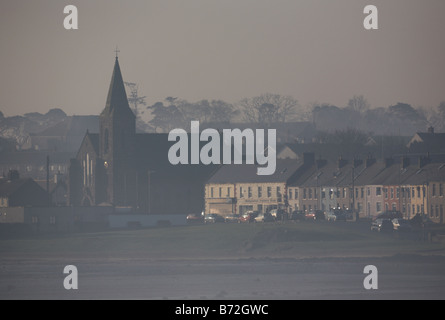 early morning view of Ballywalter in coastal fog county down Northern Ireland UK - Stock Photo