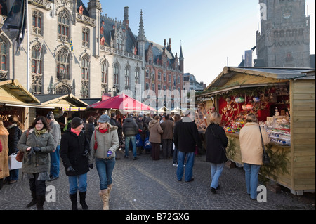 Christmas Market in the Grote Markt (Main Square) in the centre of the old town, Bruges, Belgium - Stock Photo