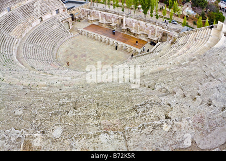 Roman amphitheater in Amman Al Qasr site Jordan - Stock Photo