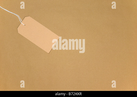Brown paper with a blank tag on string - Stock Photo