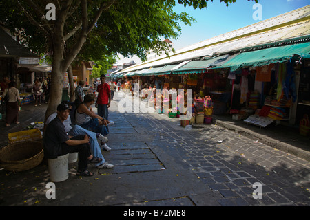 street market Port Louis Mauritius with stalls and displays with baskets handbags herbs and spices - Stock Photo