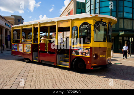 Florida Palm Beach City Place pseudo trolley tour bus , quirky bizarre old fashioned style replica trolleybus without - Stock Photo