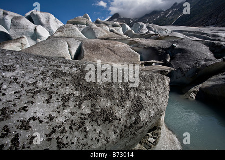Ice breaking up at the bottom of the Rhonegletscher, Switzerland, melting to form the source of the Rhone river - Stock Photo