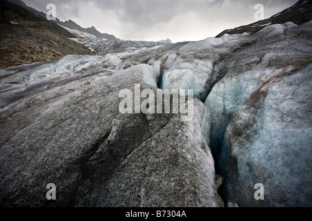 Close up of dirty upper surface of the Rhonegletscher, looking up the glacier, Switzerland