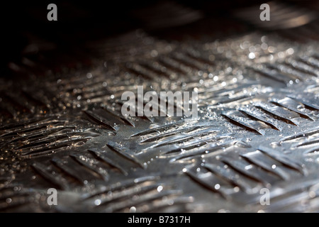 Artistic close-up of a steel tread plate - Stock Photo