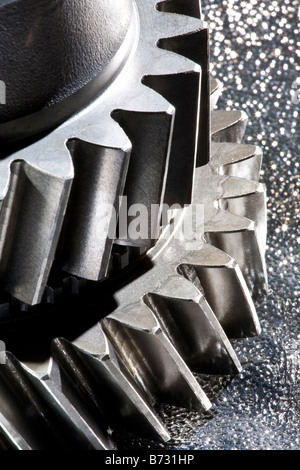 Artistic close up of metal cogs from a motor vehicle engine - Stock Photo