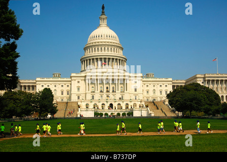 Students in yellow T shirts during a school excursion at the United States Capitol, Washington D C, USA - Stock Photo