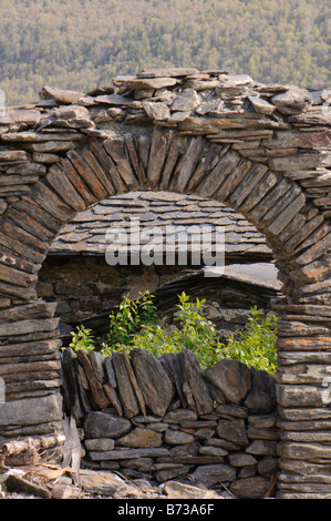 Entrance stoned arch to an old farm, Pyrenees, Spain - Stock Photo