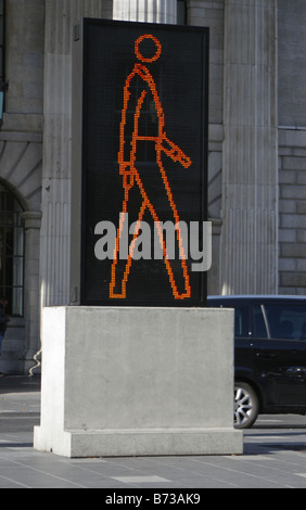 Large sign in the middle of Dublin, Southern Ireland, indicating that it is safe to cross the road. - Stock Photo
