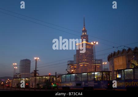 Warsaw s Palace of Culture floodlit at night seen across Marshalkowska - Stock Photo