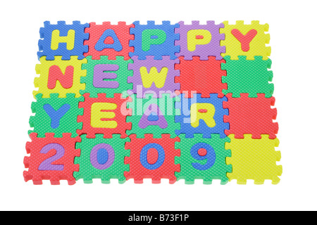 Colorful alphabet puzzle blocks assembled to display Happy New Year 2009 - Stock Photo