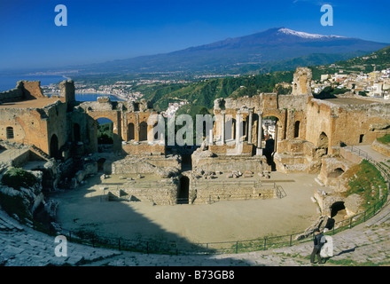Teatro Greco in Taormina and Mount Etna in distance Messina province Sicily Italy - Stock Photo